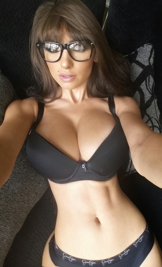 Erotic girl with hot body and glasses