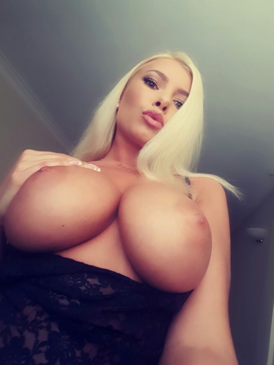 Big blonde tits from bottom close