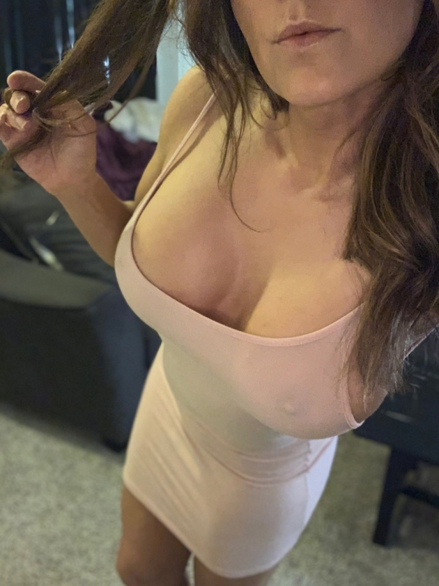 Busty girl with hard nipples making selfie